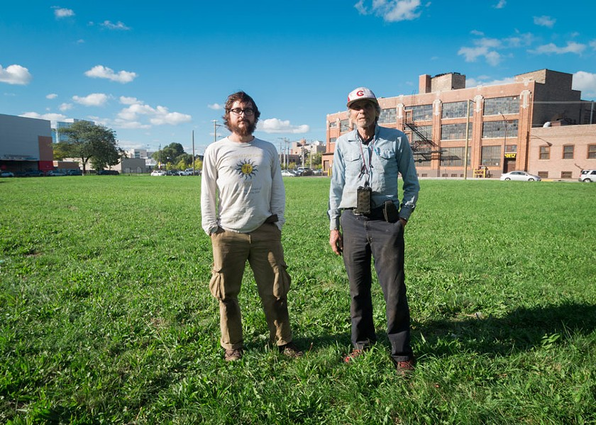 Dunn, right, and sales manager David Durstewitz in the lot that will become the farm's new home. - LOGAN JAVAGE