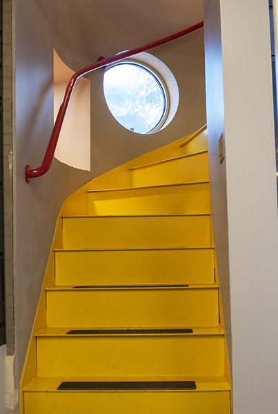 Spiral stairs with portholes wind through the five levels of the cottage. - ANDREA BAUER