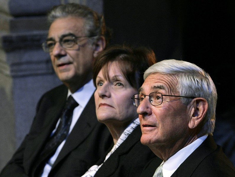 Edythe and Eli Broad, center and right, are major donors to American charter schools—and to education coverage in the LA Times. - AP/REED SAXON