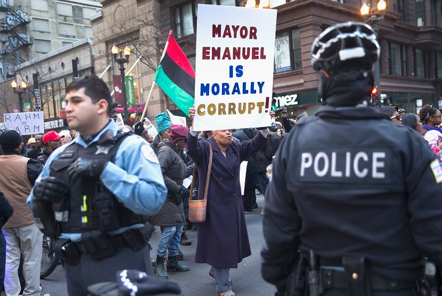Protesters calling for Rahm Emanuel's resignation marched down State Street December 6. - SCOTT OLSON/GETTY IMAGES