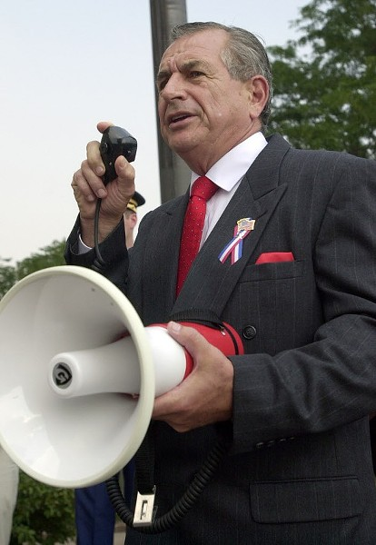 Judge Vincent Gaughan, a past commander of the Illinois American Legion, leads a 9/11 observance in front of the Cook County Criminal Courthouse in 2003. - AL PODGORSKI/SUN-TIMES