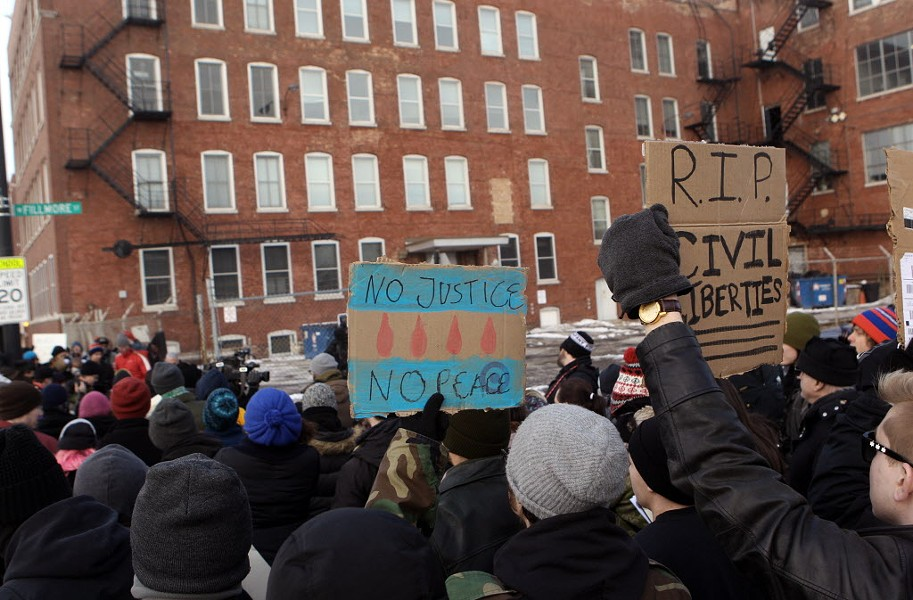 Protesters at a February 2015 rally call for the closing of Homan Square. - KEVIN TANAKA/SUN-TIMES