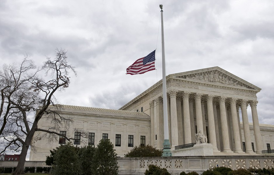 The flag in front of the Supreme Court building flies at half-staff for late Justice Antonin Scalia. - AP/J. SCOTT APPLEWHITE, FILE