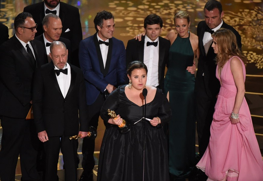 The production team and cast members of Spotlight accept the award for Best Picture. - AFP PHOTO / MARK RALSTON