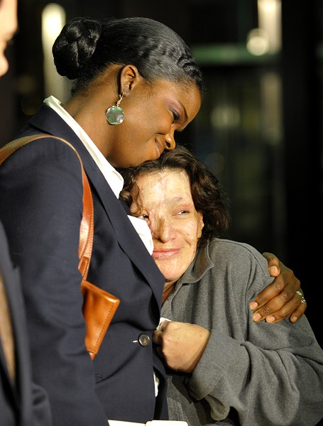 Foxx, pictured in 2010 during her time time as a Cook County assistant state's attorney, comforts Esperanza Medina, the victim of an acid attack. - DOM NAJOLIA/CHICAGO SUN-TIMES