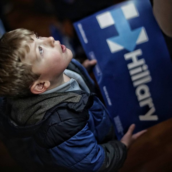 A young Hillary Clinton supporter watches Hillary's victory speech during Primary Day Tuesday night. - CHRIS RIHA