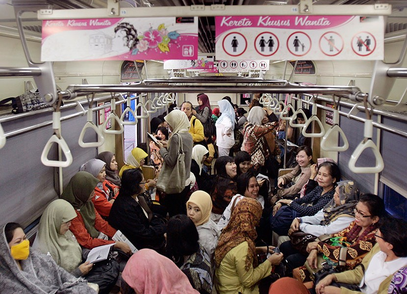 Indonesian women board a women-only carriage of a commuter train on the outskirt of Jakarta, Indonesia. - IRWIN FEDRIANSYAH/AP