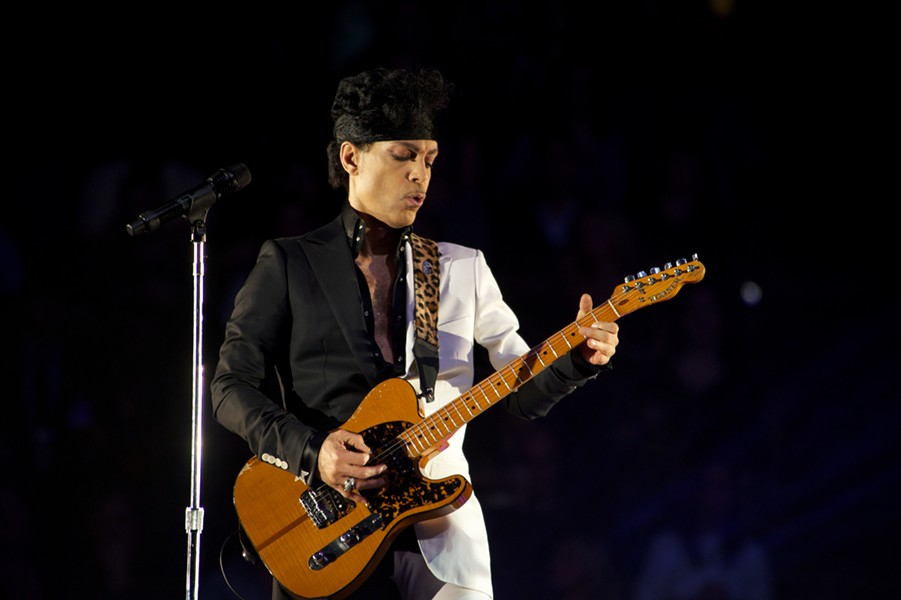 Prince performing at the United Center in 2012 - BOBBY TALAMINE