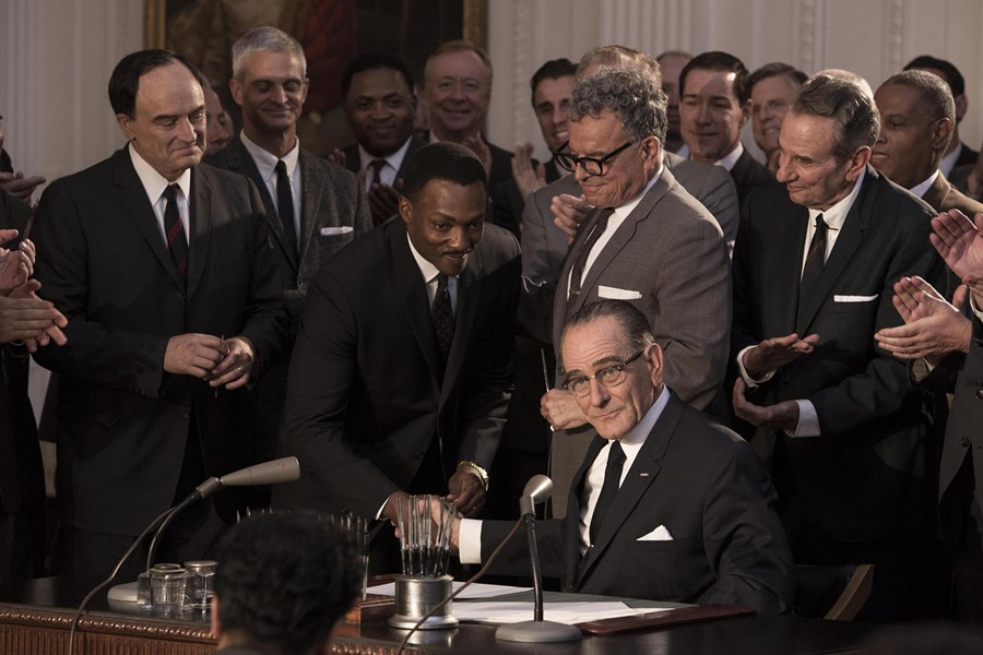 LBJ signs the Civil Rights Act, surrounded by Sen. Hubert Humphrey (Bradley Whitford), Dr. Martin Luther King Jr. (Anthony Mackie), and Sen. Everett Dirksen (Ray Wise) in All the Way.