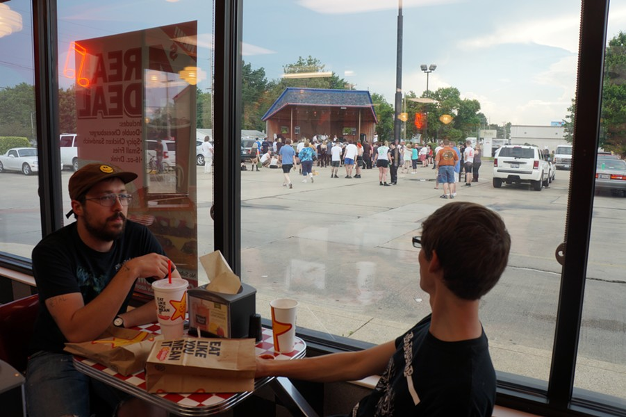 Springfield natives Alistair Reynolds and Drew Kodrich eat inside Rock 'n' Roll Hardee's during the show. - SEAN NEUMANN
