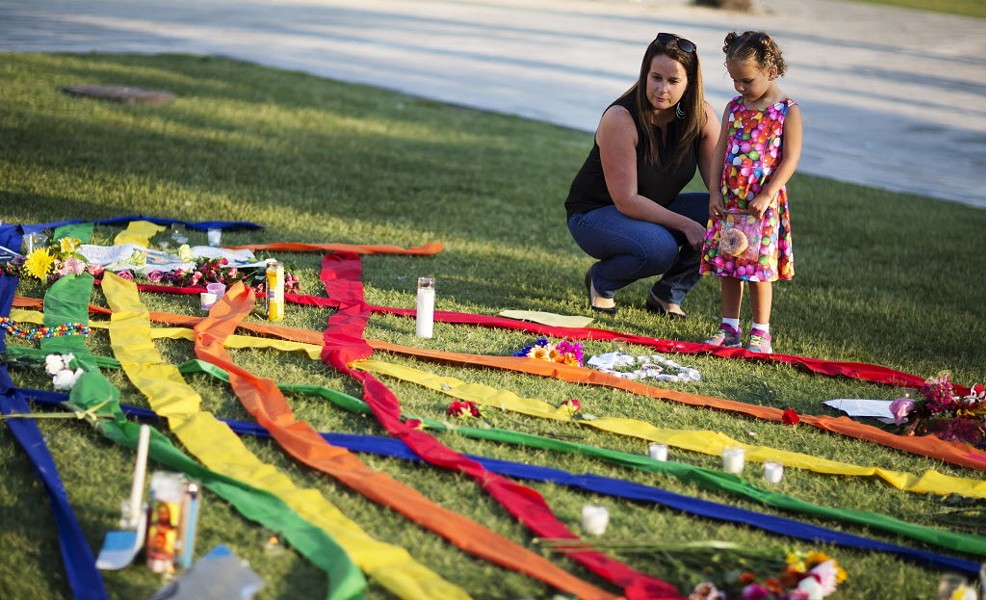Rhonda Rodeffer visits a makeshift memorial in Orlando with her four-year-old daughter, Kennedy. - DAVID GOLDMAN/AP PHOTOS