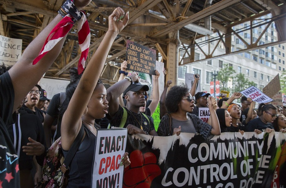 Thousands of protestors took to the streets of downtown Chicago Monday during a march against police shootings. - KELLY WENZEL/ FOR THE SUN-TIMES