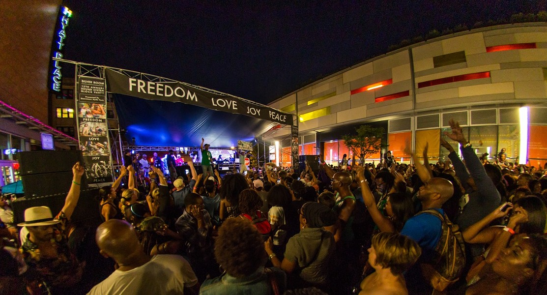 Block party host Mario Smith of WHPK on the Freedom Stage at Harper Court - CHRISTOPHER ANDREW