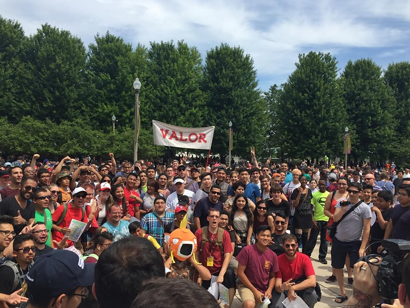 A few thousand Pokémon Go players gathered at the Bean on July 17. - RYAN SMITH