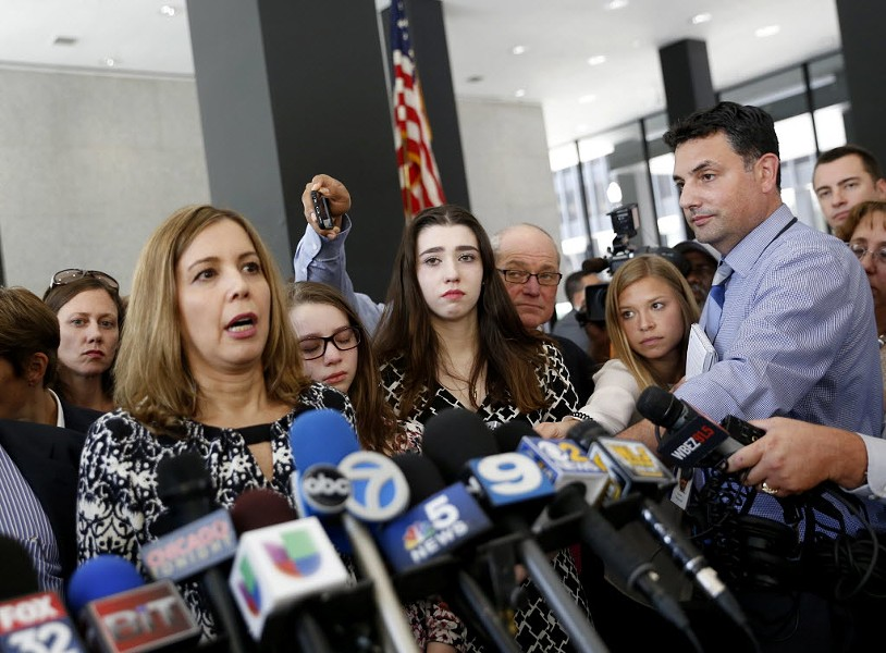 Patti Blagojevich, left, wife of former governor Rod Blagojevich, speaks at the federal courthouse after a U.S. district court judge resentenced Blagojevich to his original 14-year term. - AP PHOTO/TAE-GYUN KIM