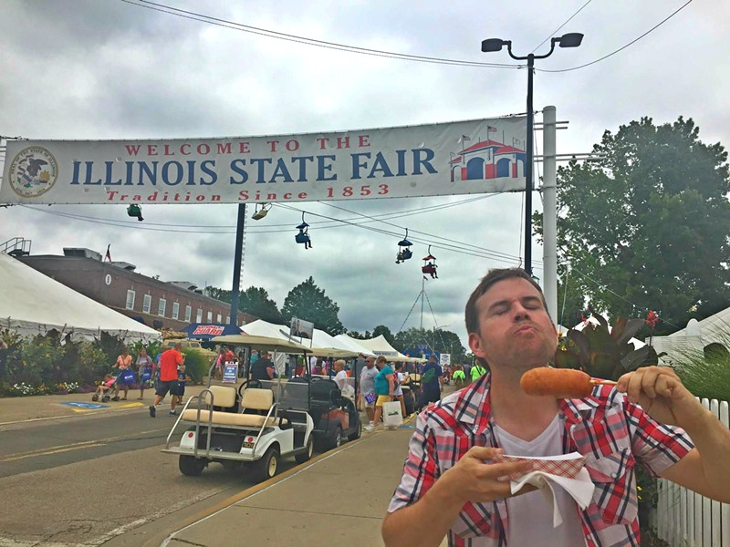 The author savors his first bite of a deep-fried Twinkie at the Illinois State Fair. - HADLEY AUSTIN