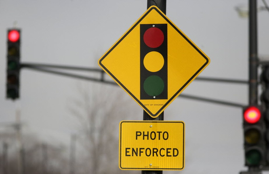A sign warns motorists of the presence of a red-light camera in Chicago. - AP PHOTO/M. SPENCER GREEN, FILE