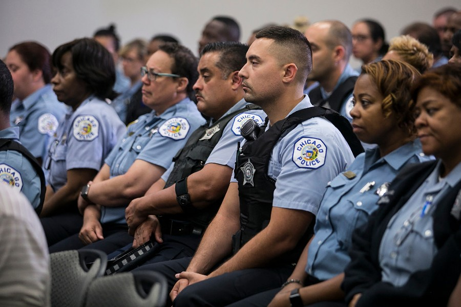 More than 100 Chicago Police officers gathered at the department's headquarters to hear superintendent Eddie Johnson announce the hiring of 970 new police officers over the next two years. - ASHLEE REZIN FOR THE SUN-TIMES
