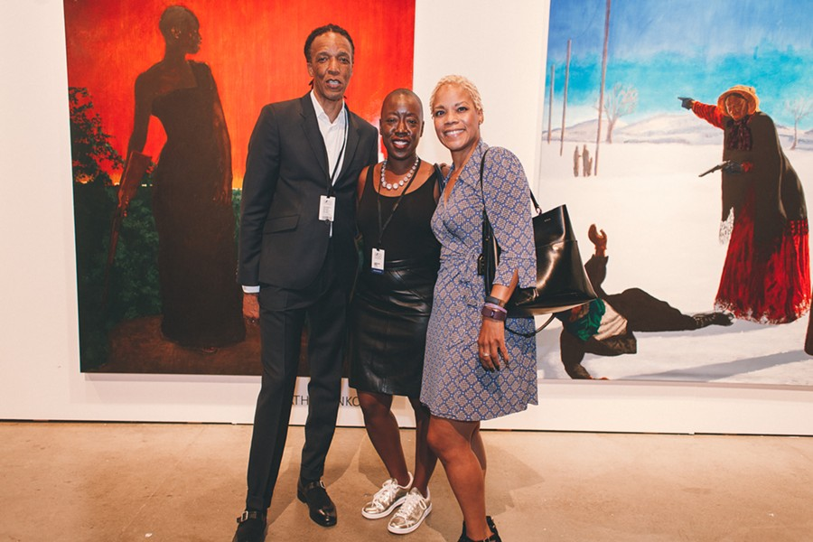 Gallery Momo owner Monna Mokoena, Jeffreen Hayes, and Rehema Barber at Mokoena's booth - DANIELLE A. SCRUGGS