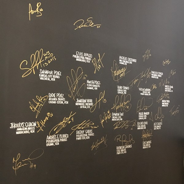 The wall of fame at Bienmesabe - MIKE SULA