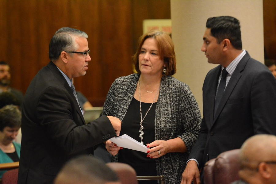 Aldermen Gilbert Villegas, Sue Sadlowski Garza and Ameya Pawar chat during the Chicago City Council meeting Wednesday. - BRIAN JACKSON/FOR THE CHICAGO SUN-TIMES
