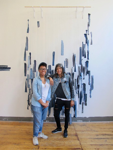 Organizers Amanda Harth of the Runway Addicts blog and Ciera McKissick of AMFM online magazine pose in front of an installation by Jane Georges. - ISA GIALLORENZO