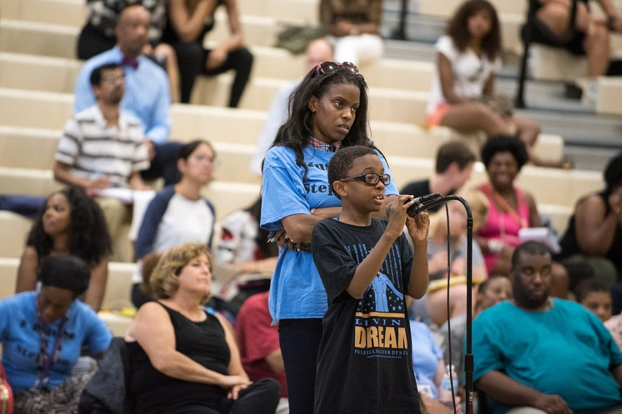 Eleven-year-old J'dyn Simmons, right, talks about his fear of police during a public forum hosted by the U.S. Department of Justice at Truman College in July. - MAX HERMAN/FOR THE SUN-TIMES