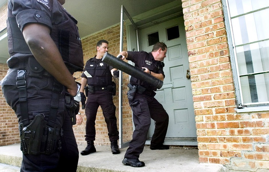 Cook County sheriff's deputies conduct an eviction in Park Forest in 2008. - JOSEPH P. MEIER/SOUTHTOWN STAR