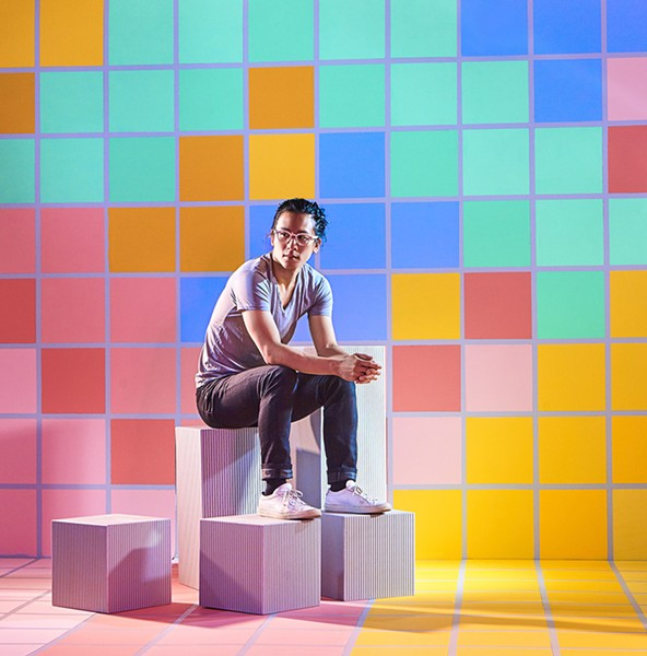 Video game designer William Chyr in a colorful, pixelated landscape - COLLEEN DURKIN; PROPS BY DOUG JOHNSTON