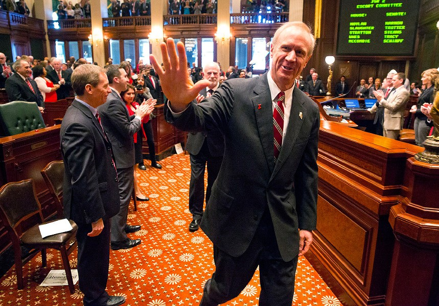 Illinois governor Bruce Rauner acknowledges Republican lawmakers as he approaches the dais to deliver his budget address Wednesday. - RICH SAAL/THE STATE JOURNAL-REGISTER VIA AP