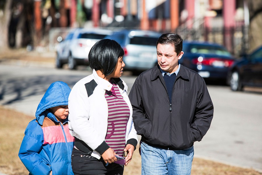 Alderman Raymond Lopez, right, with West Englewood resident Yolanda Scott and her seven-year-old daughter in front of Henderson Elementary School, where 12-year-old Kanari Gentry-Bowers was shot February 12 - JAMES FOSTER/ FOR SUN-TIMES MEDIA