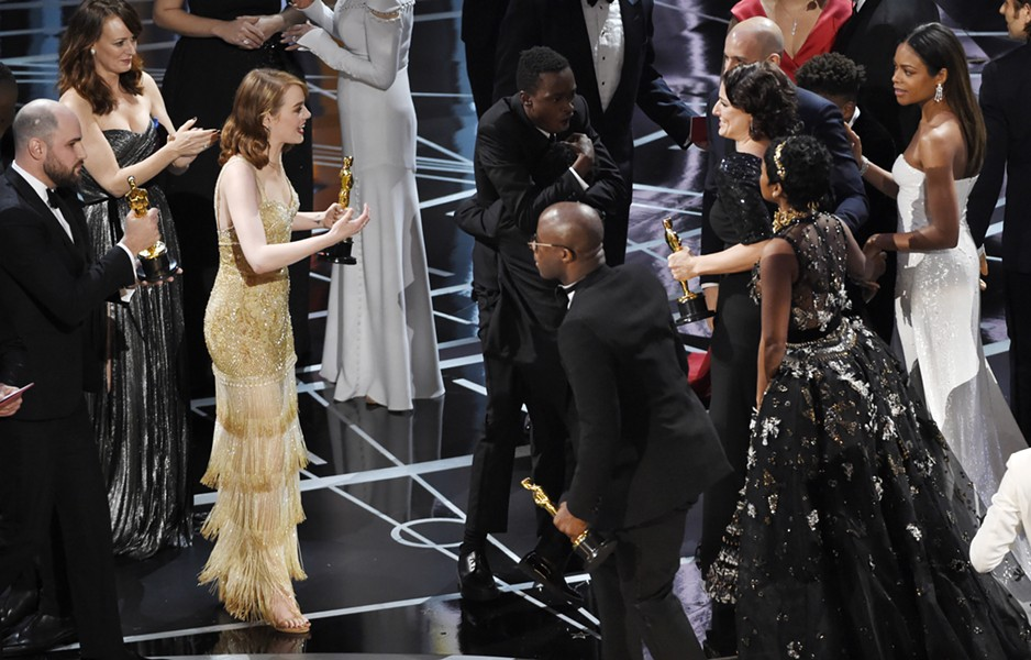 After a shocking mixup, the cast and crew of La La Land greet the cast and crew of Moonlight as they take the stage to claimed their Academy Award for best picture. - CHRIS PIZZELLO/INVISION/AP