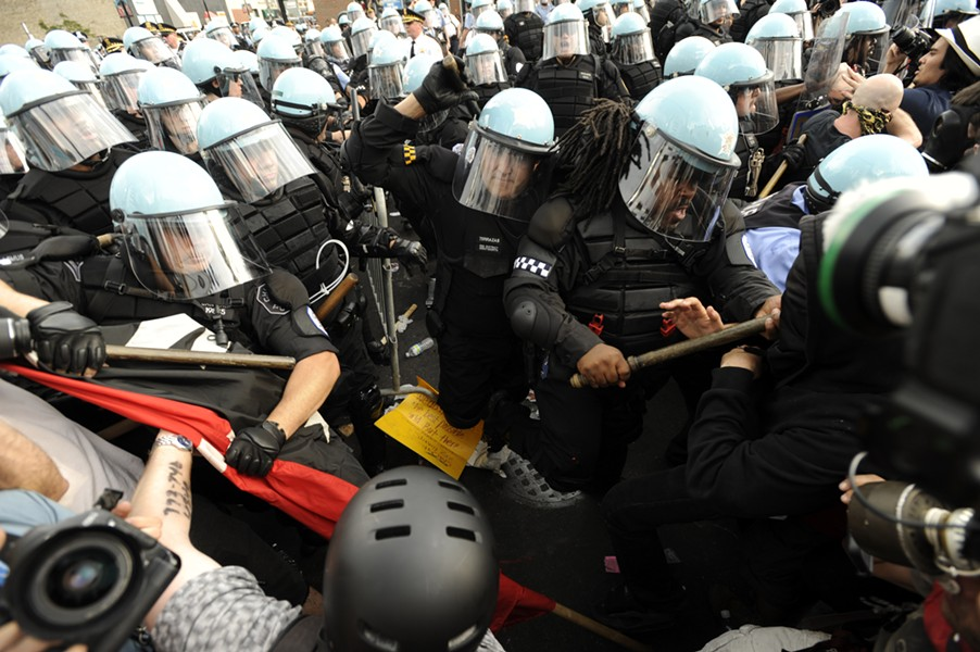 Chicago police scuffle with demonstrators during the protest of the NATO summit in May 2012. - AP PHOTO/PAUL BEATY