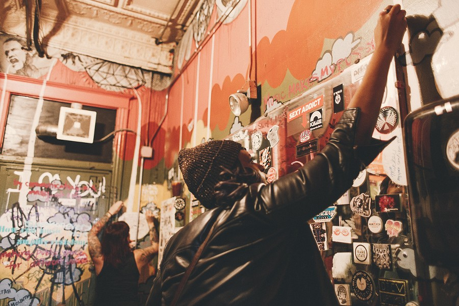 """Guests share their answers to the question """"How can music amplify resistance?"""" on the walls of the Empty Bottle bathroom. - DANIELLE A. SCRUGGS"""