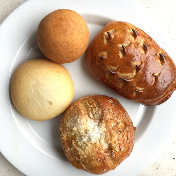 Clockwise from top left: bunuelo, pan de piña, pan de coco, pan de bono con guayaba - MIKE SULA