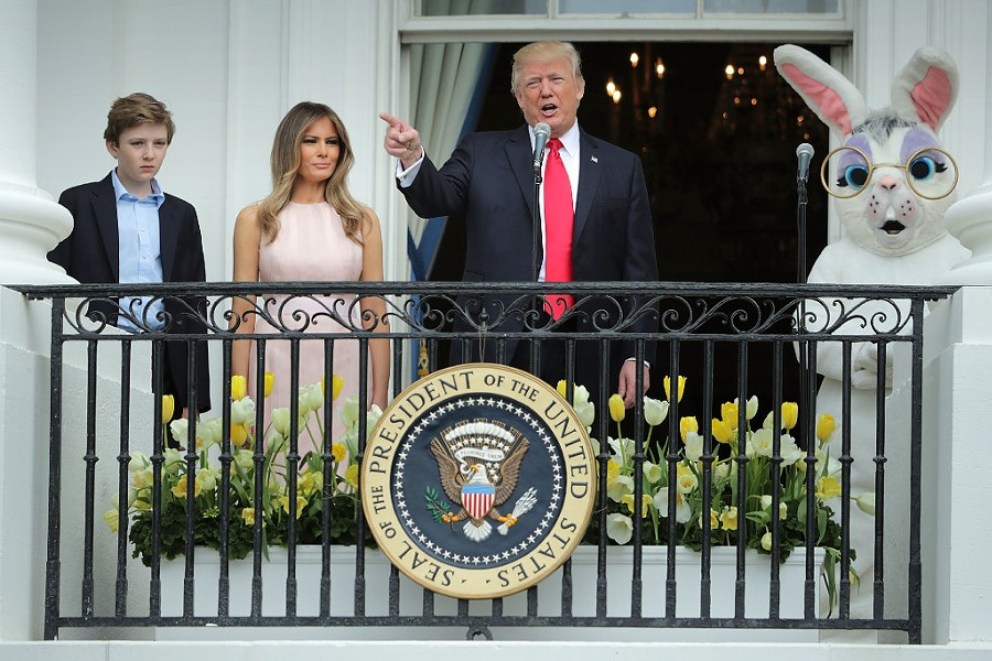 President Donald Trump delivers remarks alongside First Lady Melania Trump and their son Barron during the White House Easter egg roll Monday. - PHOTO BY CHIP SOMODEVILLA/GETTY IMAGES