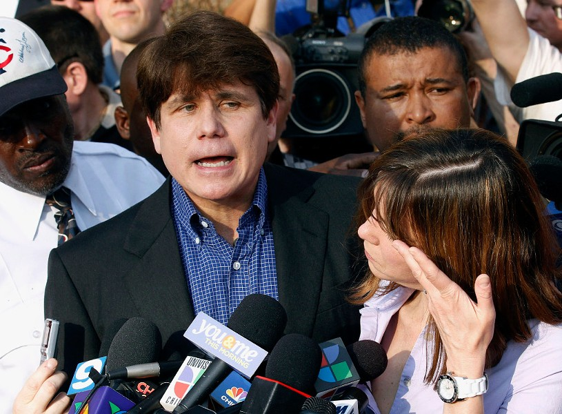 Former Illinois governor Rod Blagojevich speaks to the media in 2012. - AP PHOTO/M. SPENCER GREEN