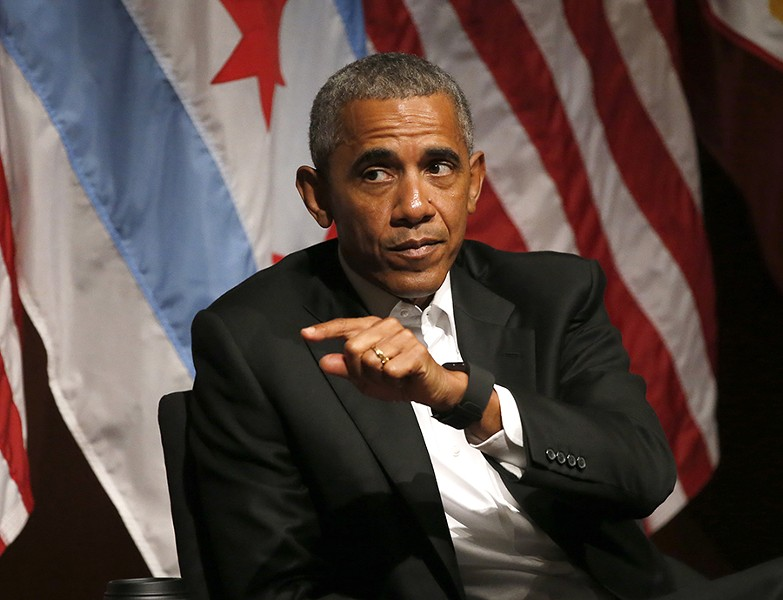 Obama didn't mention Donald Trump in his conversation on civic engagement and community organizing at the University of Chicago on April 24. - CHARLES REX ARBOGAST/AP
