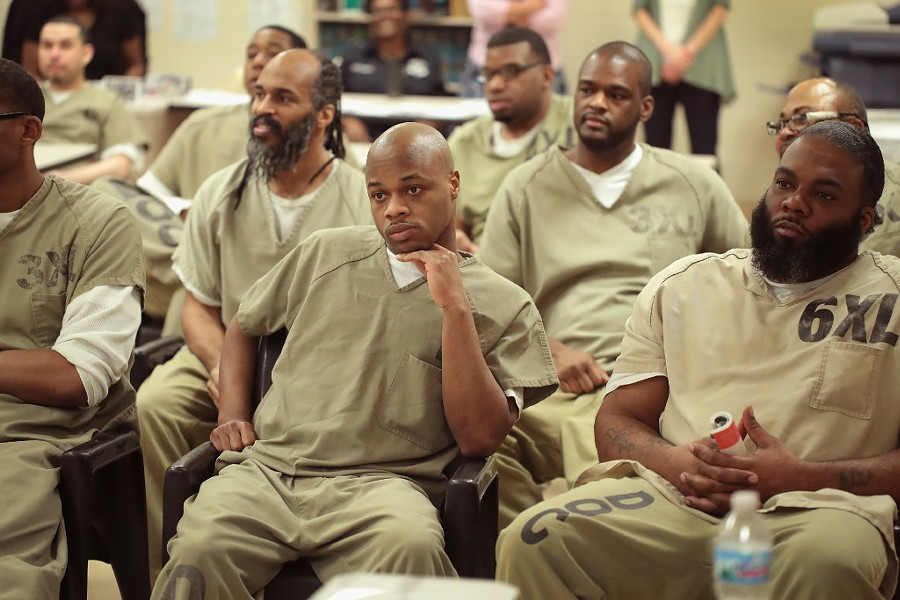 Inmates at the Cook County Jail watch as fellow inmates compete in a chess tournament online with inmates at a prison in Brazil in May. - PHOTO BY SCOTT OLSON/GETTY IMAGES