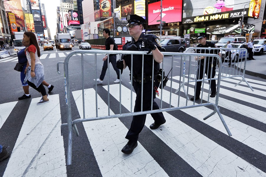 Following a vehicle attack in May, New York City police installed metal fences and concrete barriers along blocks of Times Square. - RICHARD DREW/AP