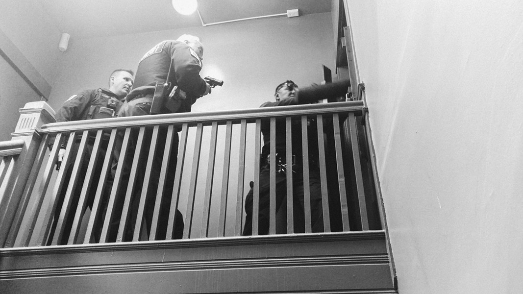 Cook County Sheriff's deputies break down a door while performing an eviction in April 2017 - MAYA DUKMASOVA