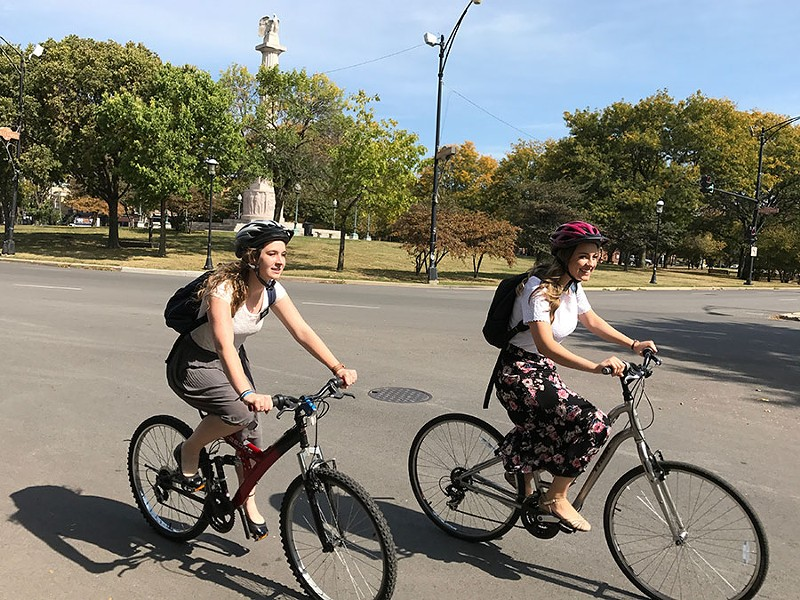 Amanda Aamodt and Emily McCrary biking near Logan Square's Mormon church - JOHN GREENFIELD