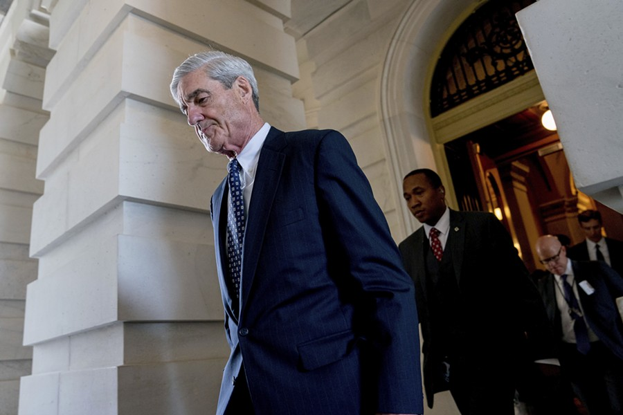Former FBI director Robert Mueller, the special counsel probing Russian interference in the 2016 election, departs Capitol Hill following a closed-door meeting in June 2017. - AP PHOTO/ANDREW HARNIK, FILE