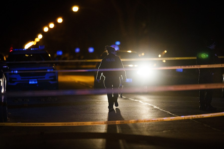 Police work the scene where a 11-year-old was shot in January. - ARMANDO L. SANCHEZ/CHICAGO TRIBUNE VIA AP