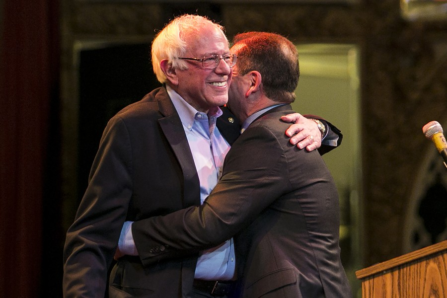 Bernie Sanders embraces Chuy García at a rally in Little Village on Thursday. - ASHLEE RESIN/SUN-TIMES