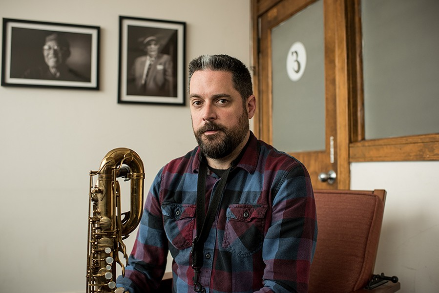 Rempis in the Elastic office, with portraits of Chicago saxophonists Fred Anderson and Von Freeman on the wall behind him. Both photographs were shot by longtime Reader contributor Jim Newberry. - CENGIZ YAR