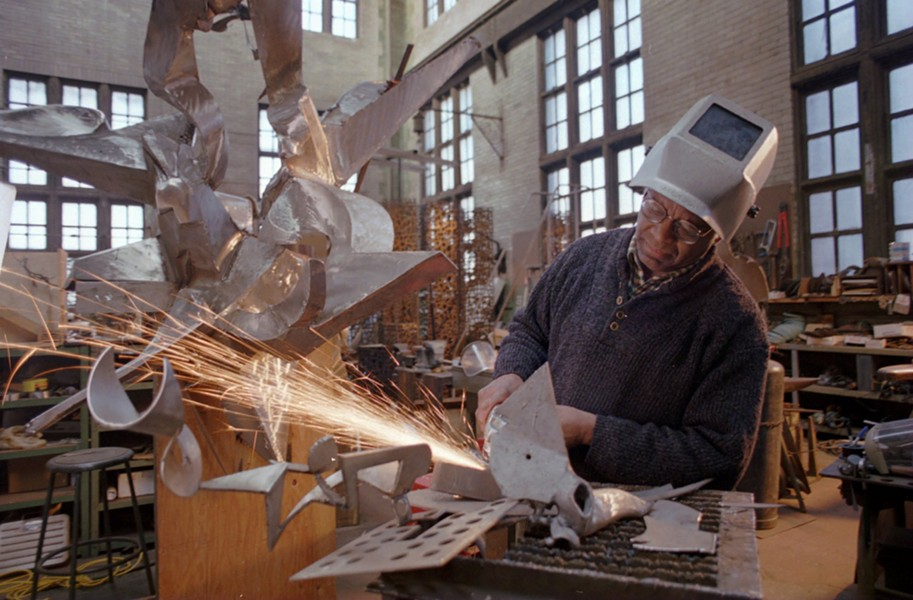 Richard Hunt welding in his studio in 1996. Now in his 80s, Hunt has created a variety of monumental public artworks on display around Chicago. - AP /JOHN ZICH