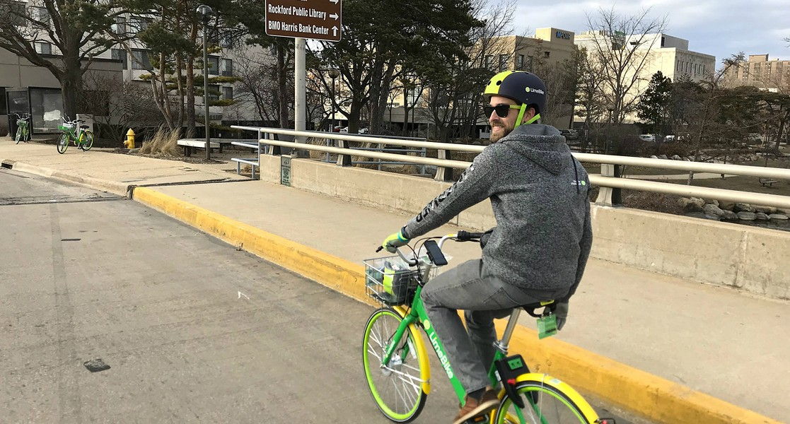 Will Piper, of LimeBike, pedals through Rockford. - JOHN GREENFIELD