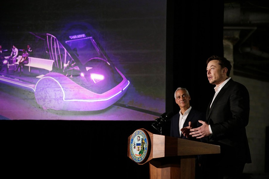 Mayor Rahm Emanuel listens to Tesla CEO and Boring Company founder Elon Musk at a press conference last week. - AP