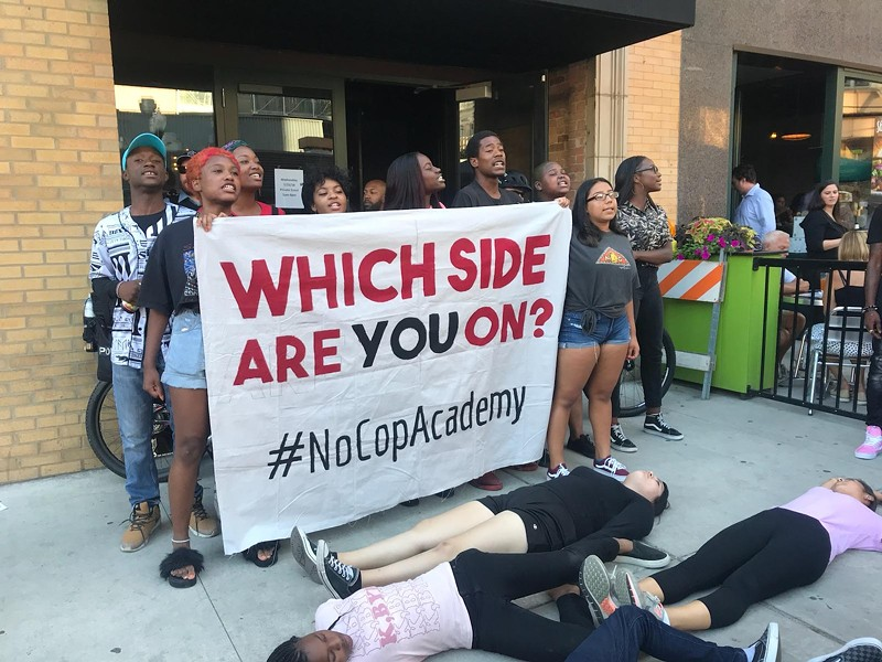 Protesters with the #NoCopAcademy campaign stage a die-in outside the Aldermanic Black Caucus's annual fund-raiser. - @NOCOPACADEMY